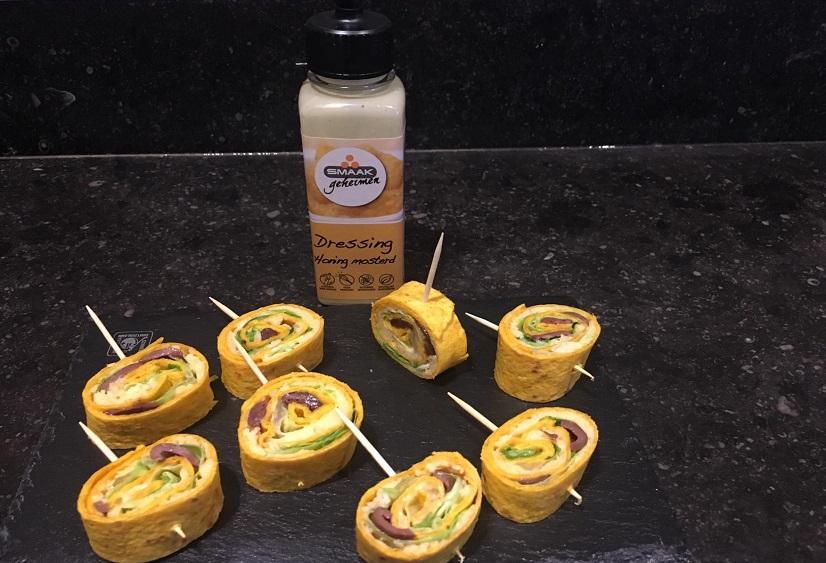 Wortel tortilla hapje met kaas en olijven